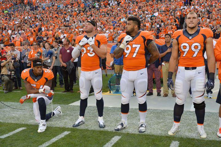 Sep 8, 2016; Denver, CO, USA; Denver Broncos inside linebacker Brandon Marshall (54) kneels during the national anthem next t