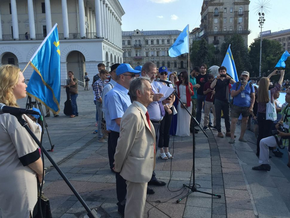 Crimean Tatar leader Mustafa Dzhemilev prepares to speak on Crimean Tatar Flag Day in Kiev, Ukraine on June 26, 2016.