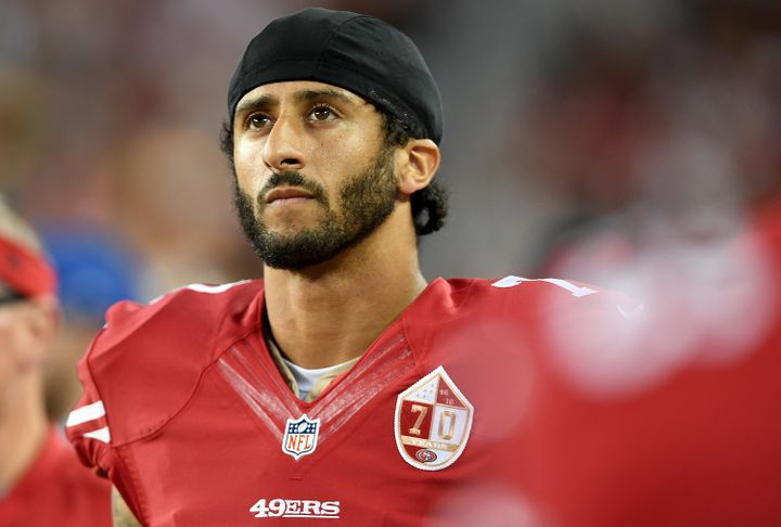 Colin Kaepernick looks on from the sidelines against the Green Bay Packers in the first half of a preseason football gam