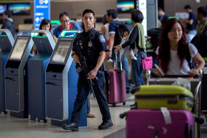 A U.S. Customs and Border Protection officer patrols Los Angeles International Airport on July 2, 2016.