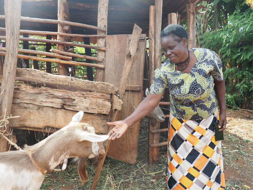 Magdalene with one of the goats she purchased with her Project Nurture income