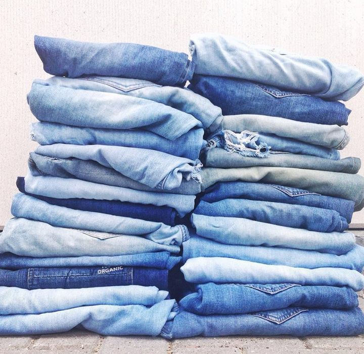 Stacks of Mud Jeans pants.