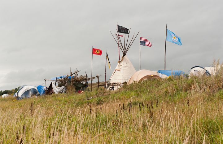 Tepees stand in the Seven Council camp, one of three encampments that have grown on the banks of the Cannon Ball River over t