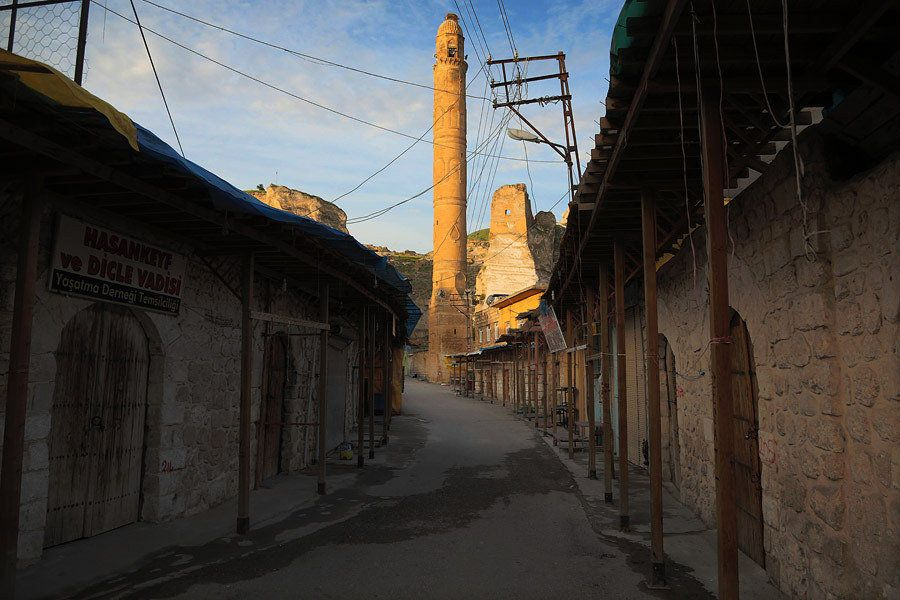 Hasankeyf's main street at sunrise. In the past, many restaurants, souvenir shops and small hotels were...
