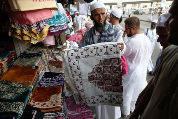 A shopkeeper shows his products to Muslim pilgrims in Saudi Arabia's holy city of Mecca, on Sept. 8