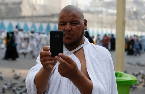 A Muslim pilgrim takes a selfie in the Saudi holy city of Mecca, on Sept. 8.