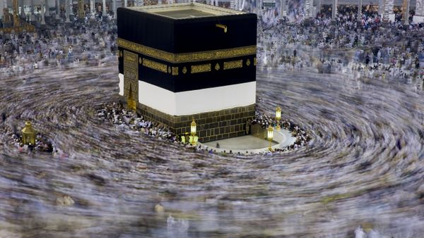 Muslim pilgrims circumambulate around the Kaaba, Islam's holiest site, located in the center of the Masjid al-Haram (Grand Mo