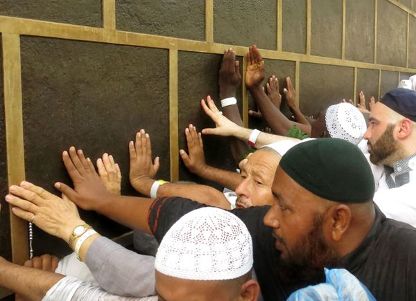 Muslim pilgrims touch Islam's holiest shrine, the Kaaba, at the Grand Mosque in the Saudi holy city of Mecca, on Sept. 6.