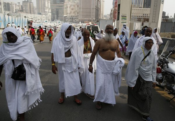 Muslim pilgrims walk in the streets of Saudi Arabia's holy city of Mecca on Sept. 6.