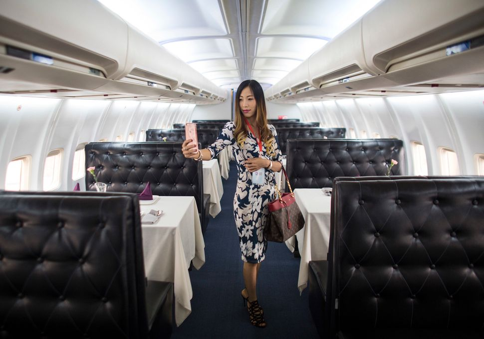 A woman poses inside Lily Airways, China's first airplane restaurant.