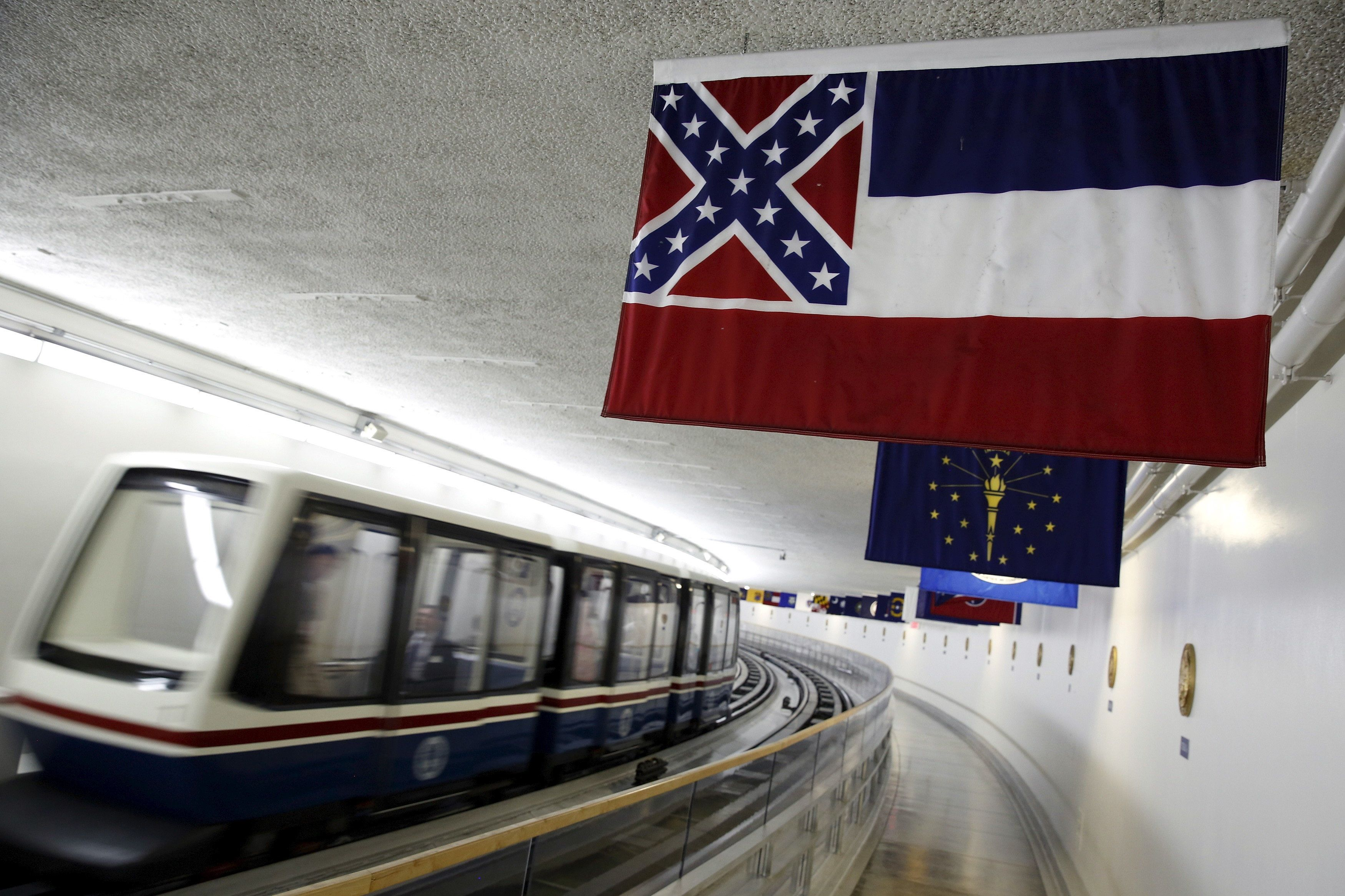 The Mississippi state flag, which incorporates the Confederate battle flag, hangs with other state flags in the subway system under the U.S. Capitol in Washington June 23, 2015. South Carolina Governor Nikki Haley on Monday called on lawmakers to take down the Confederate battle flag at that state's capitol grounds, a week after a white gunman allegedly shot dead nine black worshipers at a historic church.  REUTERS/Jonathan Ernst