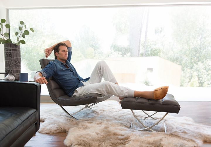 """A photo from Ugg's """"Do Nothing"""" ad campaign, featuring Tom Brady."""