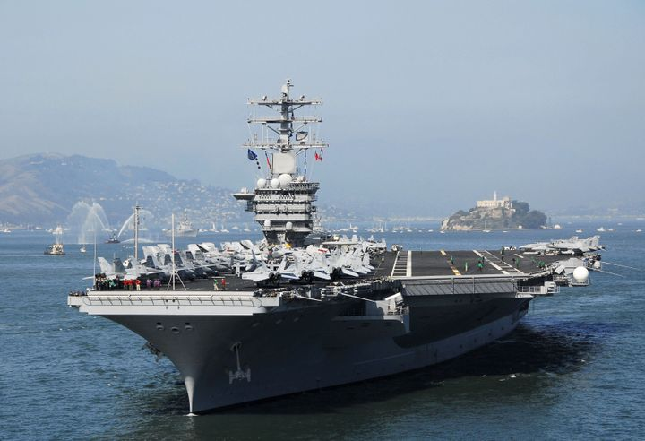 A handout picture released by the US Navy dated 07 October 2006 shows the aircraft carrier USS Nimitz as it enters San Francisco Bay during the Parade of Ships event.