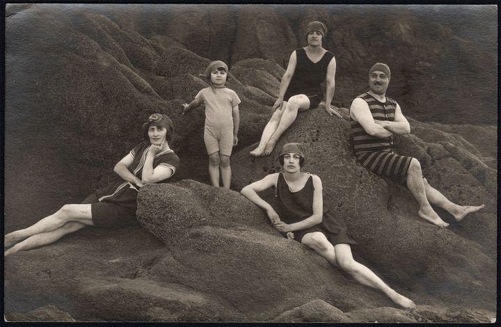 A family poses at the beach circa 1920.
