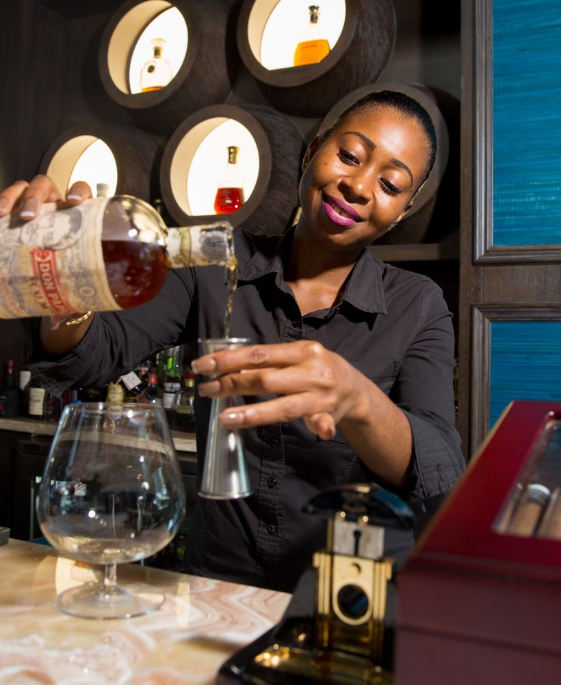 Rushelle Oliver is hard at work mastering rum