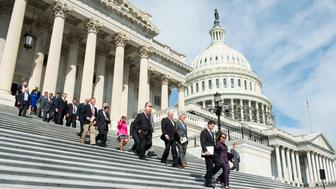 UNITED STATES - SEPTEMBER 9: Speaker of the House Paul Ryan, R-Wisc., and House Minority Leader Nancy Pelosi, D-Calif., lead the procession of members of Congress down the House Steps of the Capitol for the ceremony to mark the 15th anniversary of 9/11on Friday, Sept. 9, 2016. (Photo By Bill Clark/CQ Roll Call)