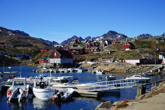 Fishing boats tied up at a port in Greenland.