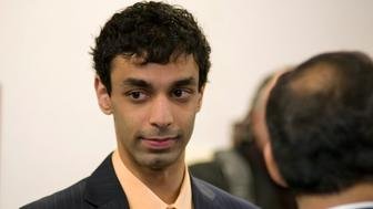 Dharun Ravi, a Rutgers University student charged with bias intimidation, listens to reporters after the jury began deliberations in the Superior Court of New Jersey in Middlesex County, New Brunswick March 14, 2012. A jury on Wednesday began deciding whether Ravi committed a hate crime when he used a webcam to spy on his college roommate Tyler Clementi kissing another man in a case that put a national spotlight on gay bullying when Clementi committed suicide days later. REUTERS/ Mark Dye  (UNITED STATES - Tags: CRIME LAW EDUCATION)
