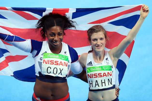 Great Britain's Sophie Hahn (gold) and Kadeena Cox (Bronze) celebrate after the Women's 100m - T38