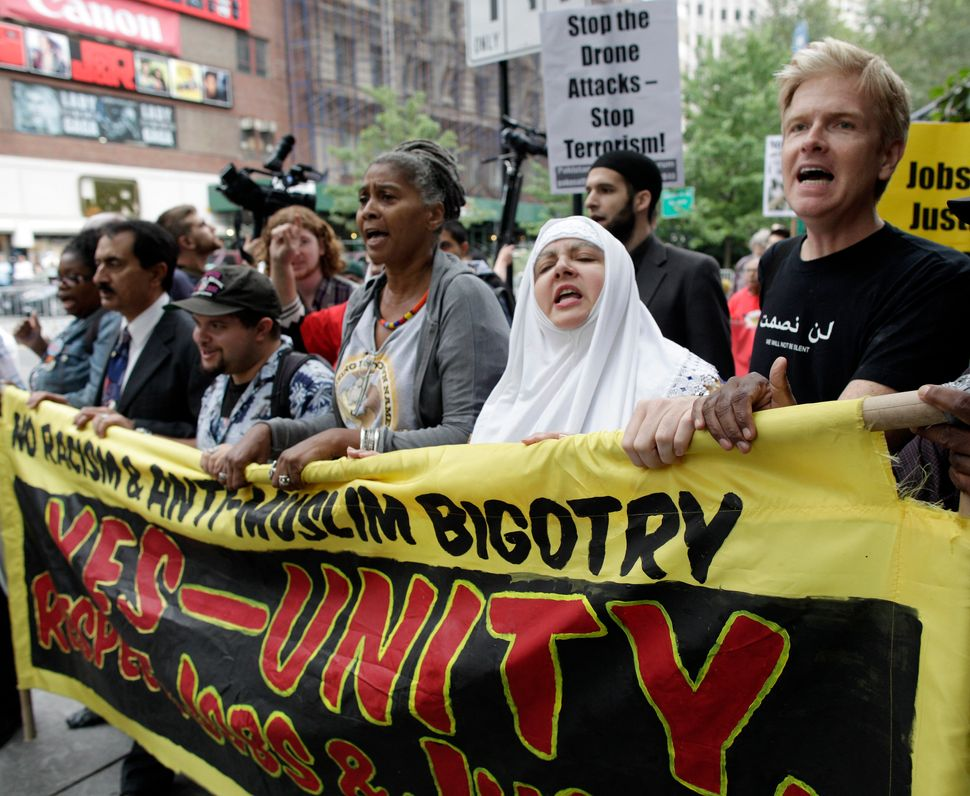 Protesters march in the Rally Against War, Racism & Islamophobia to mark the 10th anniversary of the 9/11 attacks on the