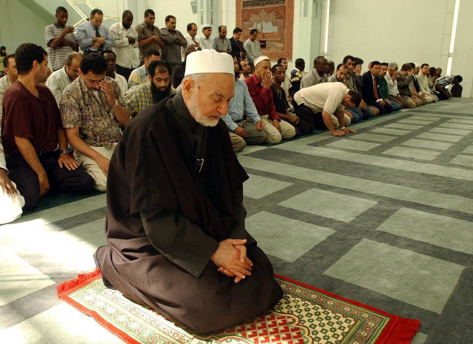 Imam Omar Abu Namous leads a remembrance prayer service at the Islamic Cultural Center in New York City on Sept. 11, 2002.