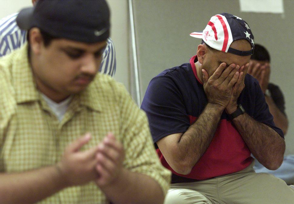 Safdar Khwaja, right, of Murraysville, Pennsylvania, takes part in a prayer service for victims of the Sept. 11 terrorist att