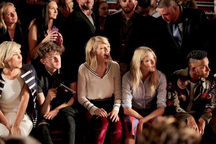 Taylor Swift and model Martha Hunt appear during New York Fashion Week on Friday.