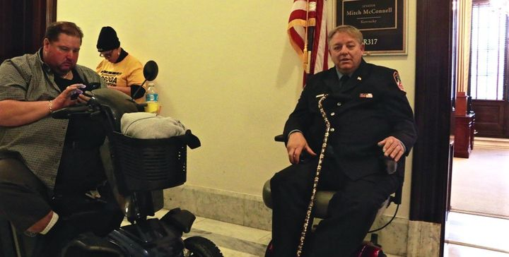 Kenny Anderson and Ray Pfeifer wait outside Mitch McConnell's office hoping to plead for his help passing a new 9/11 bill.