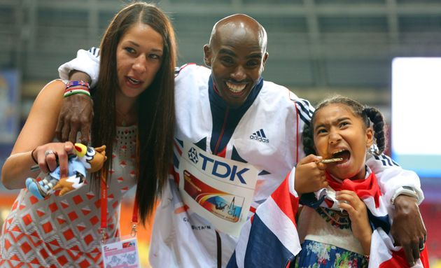 Great Britain's Mo Farah poses with his wife Tania and daughter Rihanna after winning the Men's 5000...