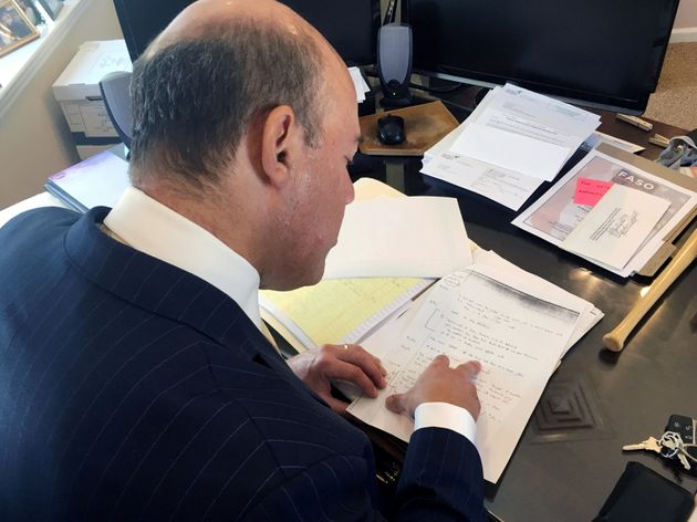 Ari Fleischer looks over 9/11 notes during an interview with Reuters in his office in Bedford, New York,...