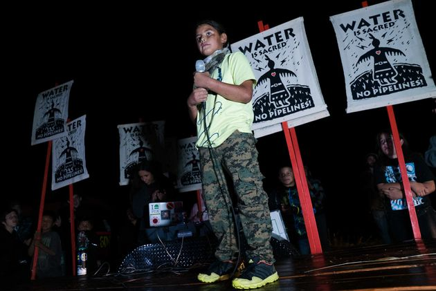 A child speaks during a rally against the pipeline's