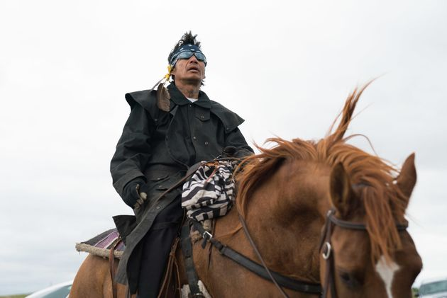 A man on horseback protests the Dakota Access Pipeline's construction during a rally in North