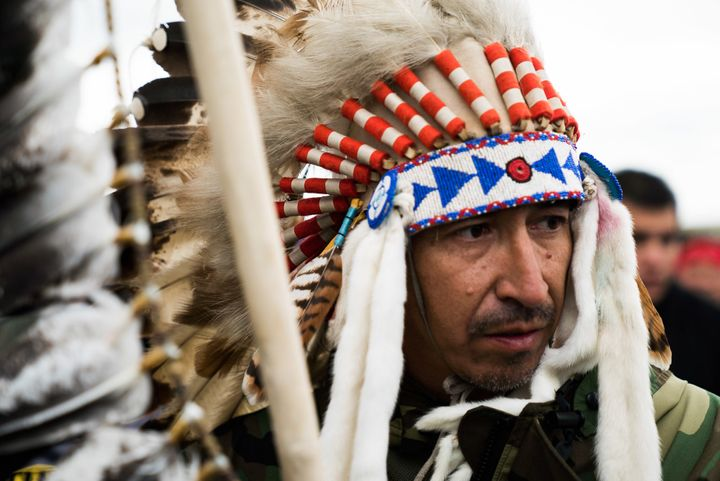 A man wears a feather-adorned headdress during a protest in Cannon Ball, North Dakota.