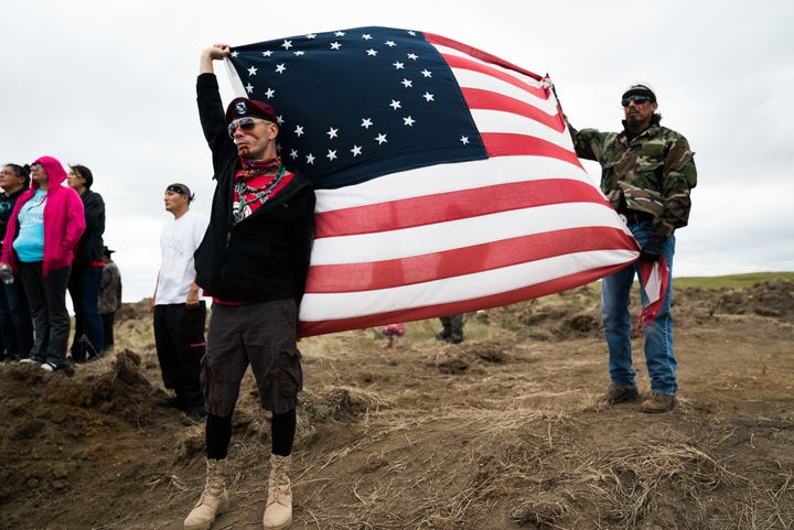Protesters wave a flag in Cannon Ball, North Dakota.