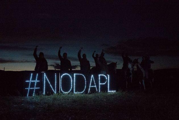 LED lights form a hashtag that protest the Dakota Access