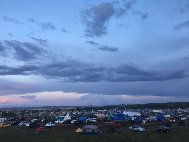 Teepees mix with camping tents, cars and RVs during weekend
