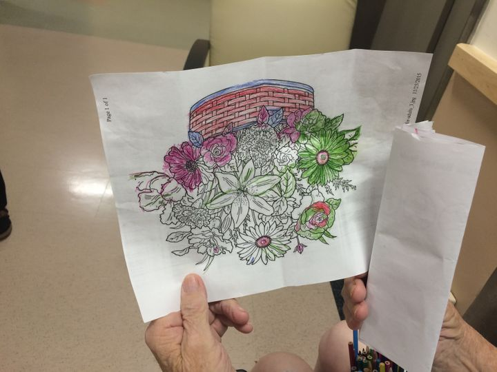 Here is a patient showing me one of his many colored pictures — note the cup full of pencils in the bottom right. 'Classic co