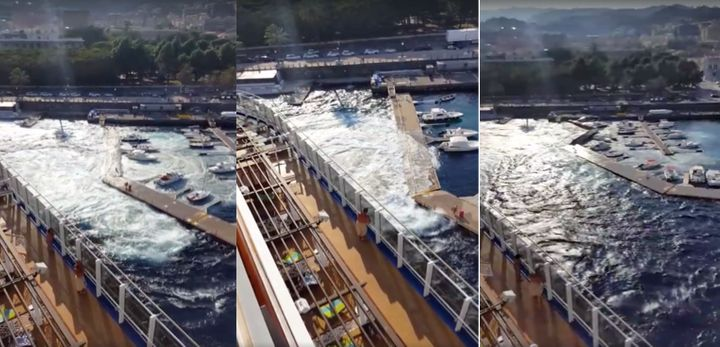A marina's dock is seen buckling and crashing into surrounding boats after getting hit by a passing cruise ship's powerful wake.