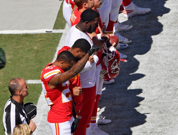 Kansas City Chiefs defensive back Marcus Peters raises his fist in the air as the National Anthem plays before Sunday's footb
