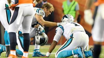 DENVER, CO - SEPTEMBER 08: Greg Olsen (88) of the Carolina Panthers checks the health of his quarterback Cam Newton (1) after he got leveled by Darian Stewart (26) of the Denver Broncos and Shaquil Barrett (48) during the fourth quarter of the Broncos' 21-20 win. The Denver Broncos hosted the Carolina Panthers on Thursday, September 8, 2016. (Photo by Joe Amon/The Denver Post via Getty Images)