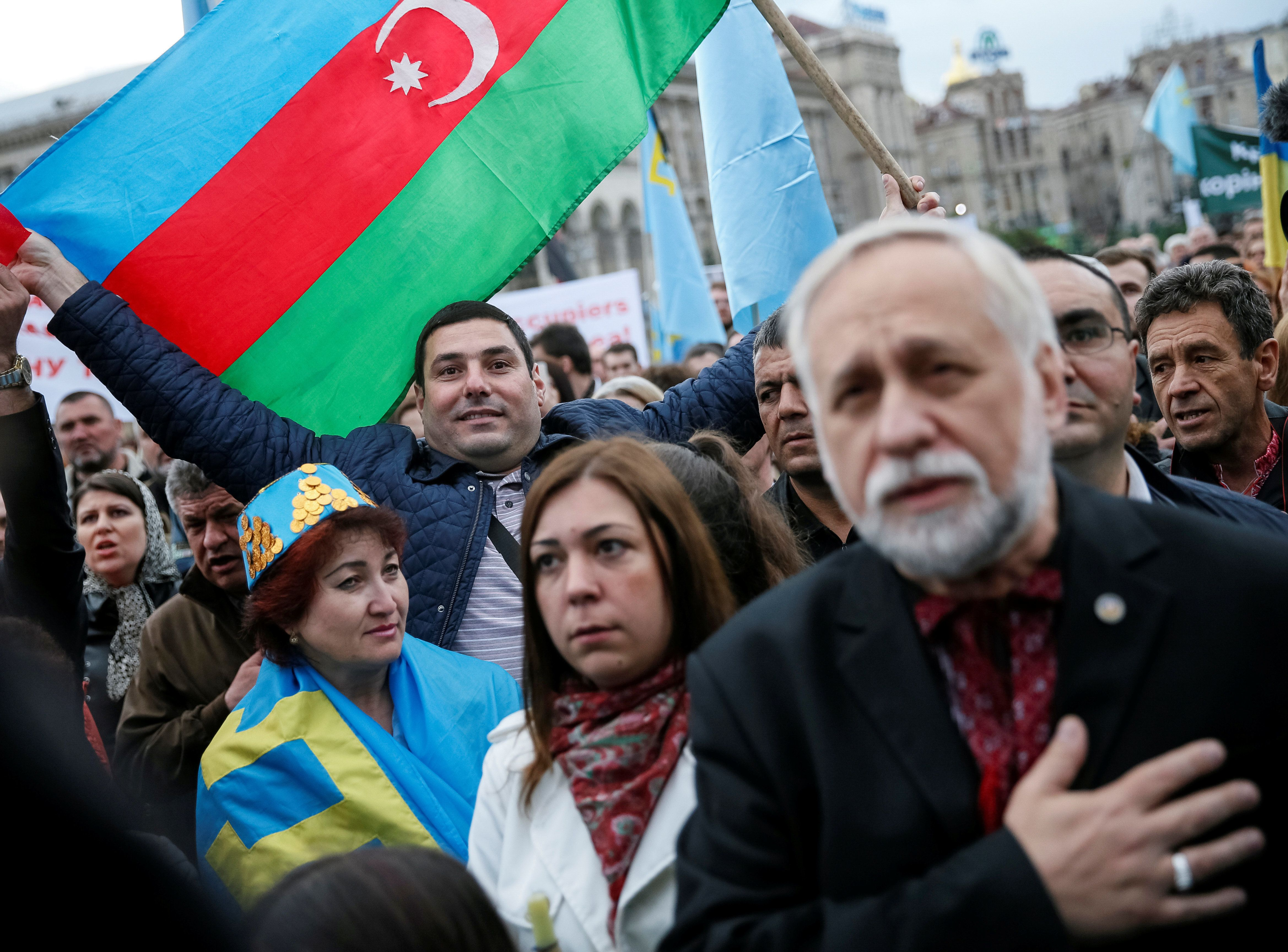 People gather to commemorate the anniversary of the deportation of Crimean Tatars from Crimea to Central...