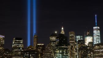 NEW YORK, NY - SEPTEMBER 11:  The 'Tribute in Light' illumiinates the skyline of Lower Manhattan as seen from the Brooklyn Heights Promenade, September 11, 2016 in New York City. Throughout the country services are being held to remember the 2,977 people who were killed in New York, at the Pentagon and in a field in rural Pennsylvania. (Photo by Drew Angerer/Getty Images)