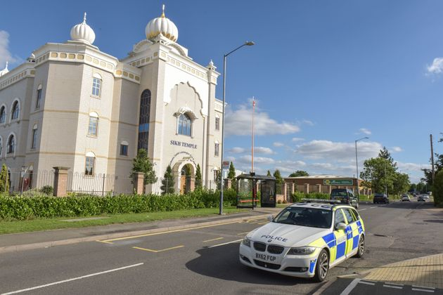 A police car outside the temple in Leamington