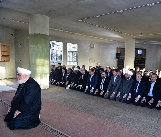 Syria's Bashar Assad prays at a mosque in the Damascus suburb of Daraya in this handout picture provided...