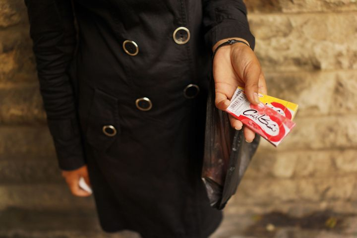 NOVEMBER 16: A Syrian woman from Kafer Hend, Syria sells chewing gum in a wealthy district of Beirut on November 16, 2013 in