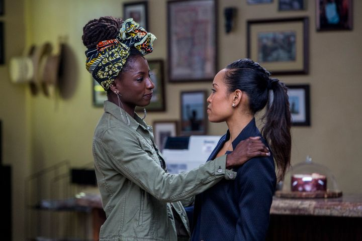 "Sisters Nova and Charley share a moment in the TV series ""Queen Sugar."""