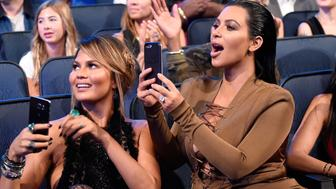 LOS ANGELES, CA - AUGUST 30:  Chrissy Teigen and Kim Kardashian West attend the 2015 MTV Video Music Awards at Microsoft Theater on August 30, 2015 in Los Angeles, California.  (Photo by Kevin Mazur/MTV1415/WireImage)