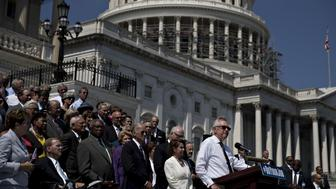Senate Minority Leader Harry Reid, a Democrat from Nevada, from right, speaks as House Minority Leader Nancy Pelosi, a Democrat from California, and U.S. Vice President Joseph 'Joe' Biden listen during a news conference next to the House steps of the U.S. Capitol building with Democratic lawmakers in Washington, D.C., U.S., on Thursday, Sept. 8, 2016. Biden went to Capitol Hill to urge Republicans in Congress to take action on issues such as Zika funding and the seat vacancy at the U.S. Supreme Court. Photographer: Andrew Harrer/Bloomberg via Getty Images