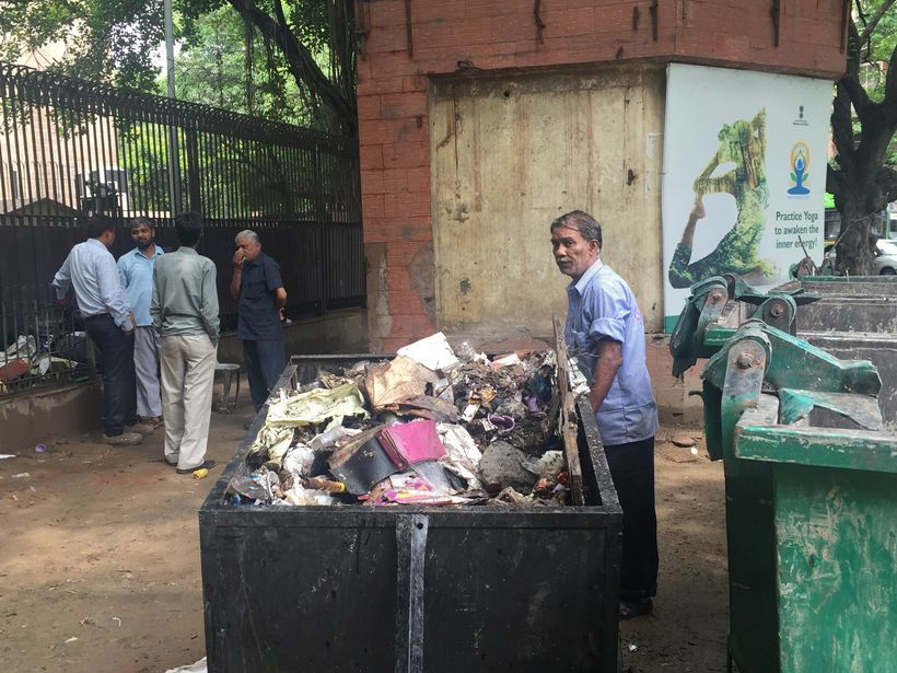 Ragpicker at waste collection site set to be demolished by NDMC.  Delhi, India