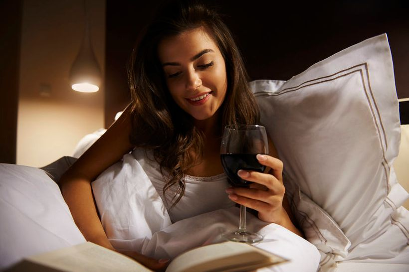 Imbibing before bed can interrupt beauty sleep.